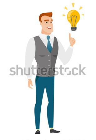 Groom pointing at business idea light bulb. Stock photo © RAStudio