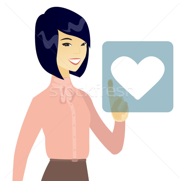 Business woman pressing web button with heart. Stock photo © RAStudio