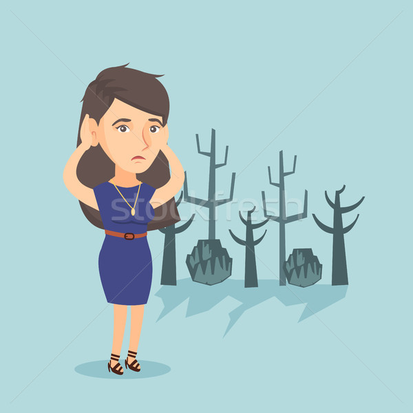 Young caucasian woman standing in a dead forest. Stock photo © RAStudio
