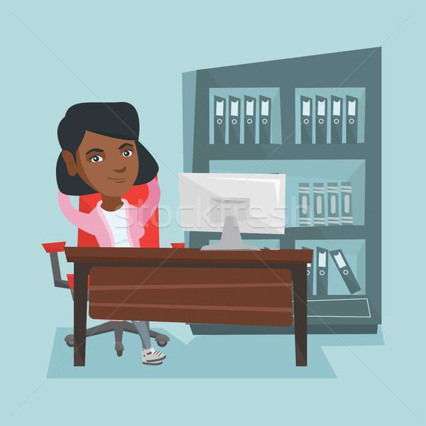 Young african-american employee relaxing in office Stock photo © RAStudio