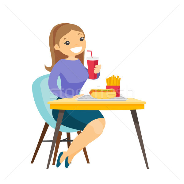 Young caucasian white woman eating fast food. Stock photo © RAStudio
