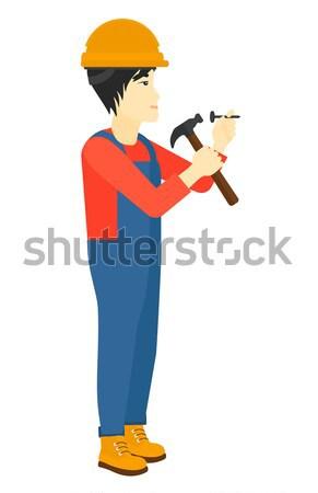 Man hammering nail. Stock photo © RAStudio