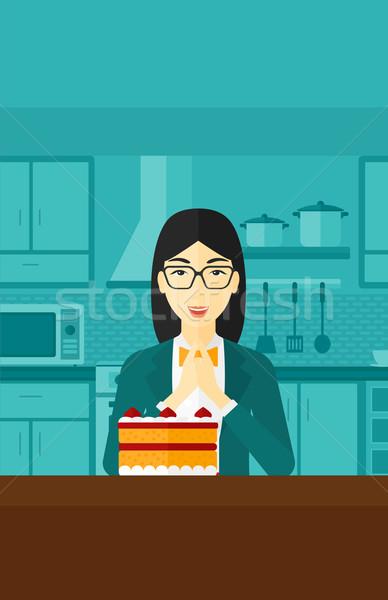 женщину глядя торт азиатских Постоянный кухне Сток-фото © RAStudio