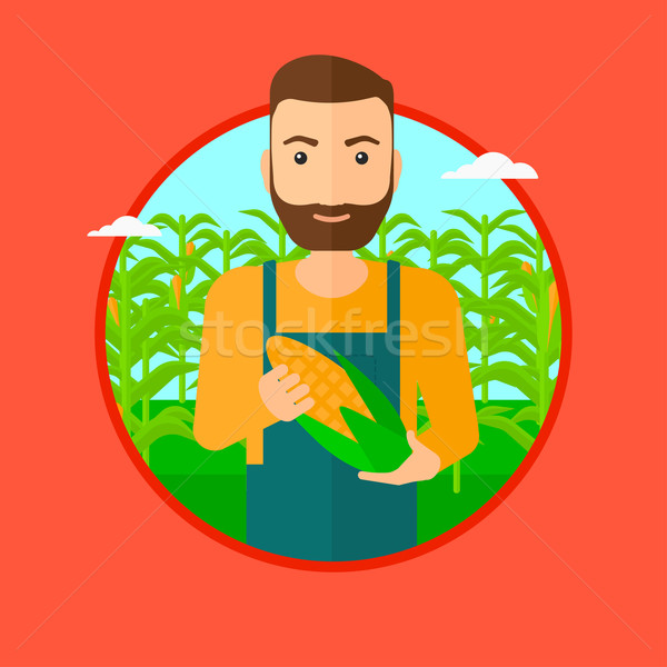 Farmer holding corn. Stock photo © RAStudio