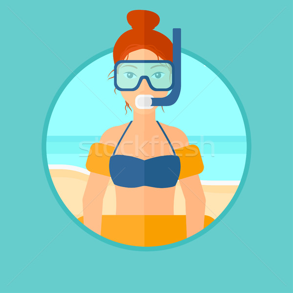 Woman with snorkeling equipment on the beach. Stock photo © RAStudio