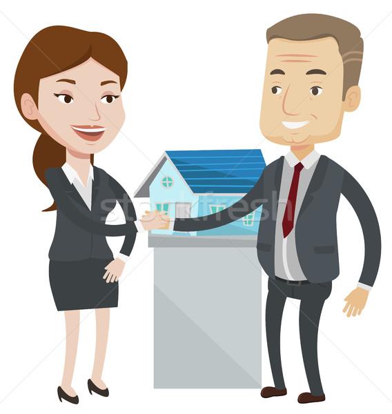 Accordo agente immobiliare acquirente cliente immobiliari Foto d'archivio © RAStudio