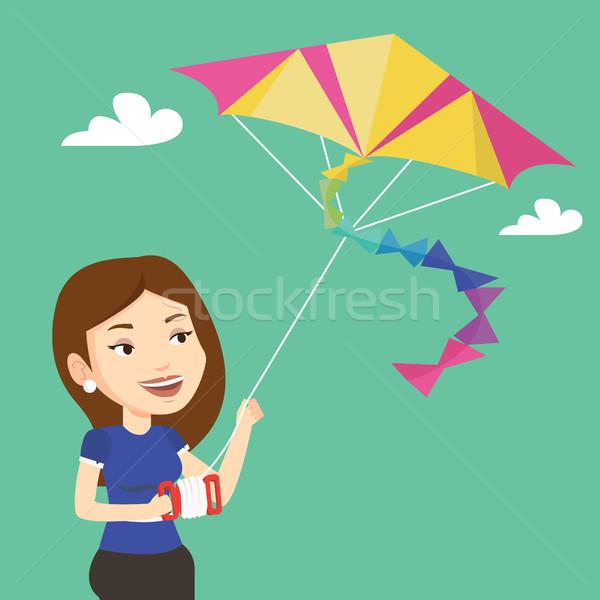 Jonge vrouw vliegen Kite jonge kaukasisch vrouw Stockfoto © RAStudio