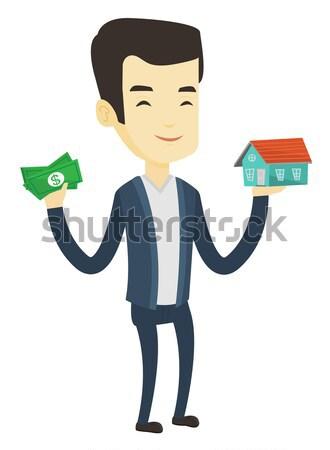 Asian man buying house thanks to loan. Stock photo © RAStudio