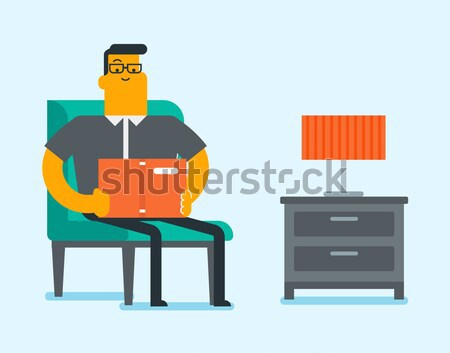 Exhausted man sleeping on suitcase at airport. Stock photo © RAStudio