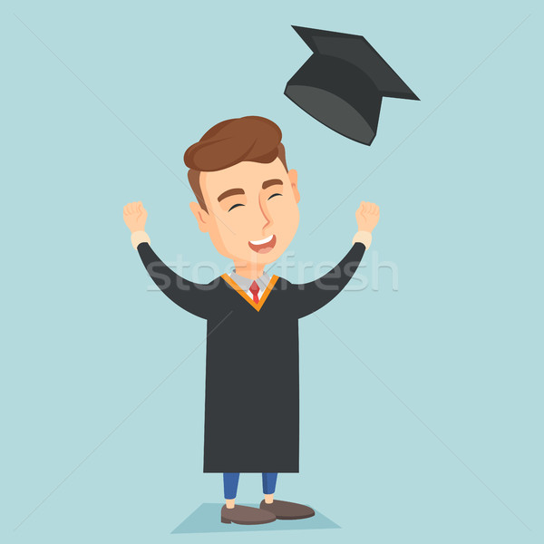 Graduate throwing up graduation hat. Stock photo © RAStudio