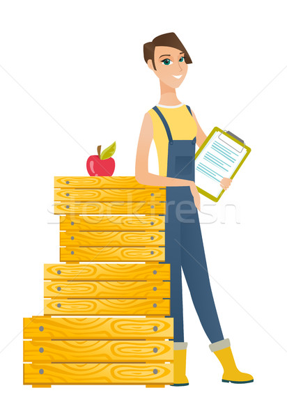 Farmer holding clipboard with documents. Stock photo © RAStudio