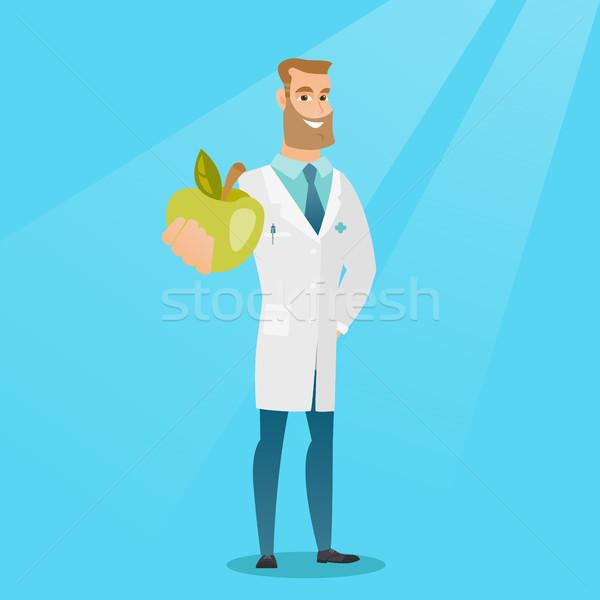 Voedingsdeskundige aanbieden vers appel jonge kaukasisch Stockfoto © RAStudio