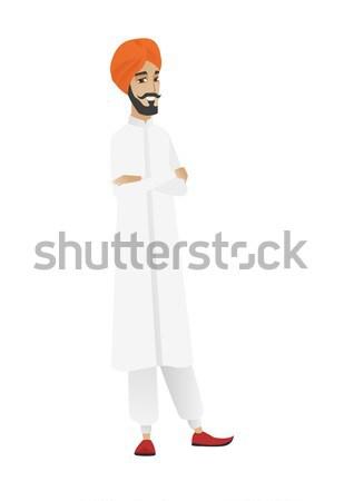 Hindu businessman showing a direction. Stock photo © RAStudio