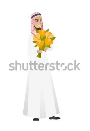 Hindu businessman holding bouquet of flowers. Stock photo © RAStudio