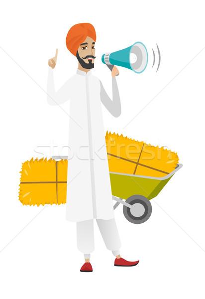 Hindu farmer talking into loudspeaker. Stock photo © RAStudio