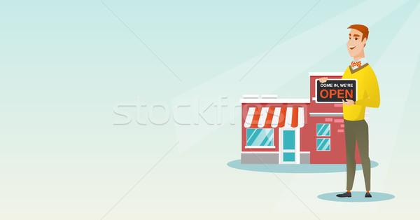 Caucasiano compras proprietário abrir amigável Foto stock © RAStudio