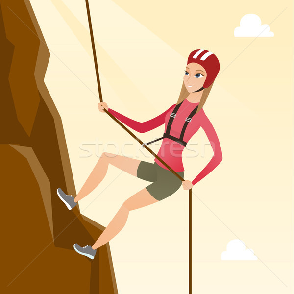 Caucasian woman climbing a mountain with rope. Stock photo © RAStudio