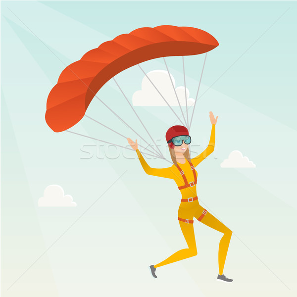 Young caucasian skydiver flying with a parachute. Stock photo © RAStudio