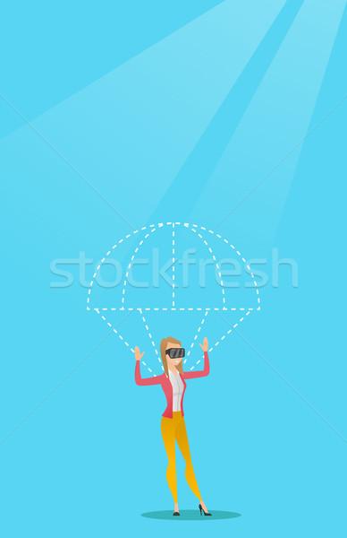 Jonge vrouw hoofdtelefoon vliegen parachute kaukasisch vrouw Stockfoto © RAStudio