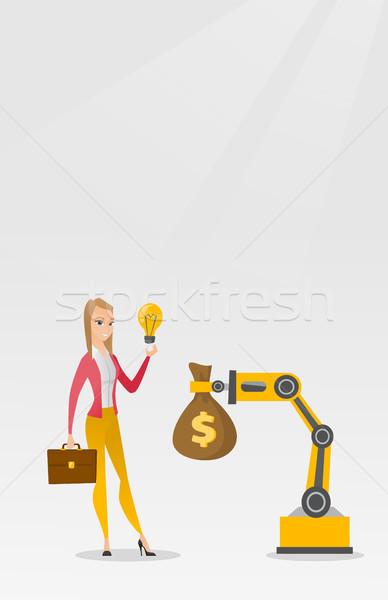 Woman selling idea of engineering of robotic hand. Stock photo © RAStudio