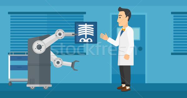 Doctor examining radiograph with help of robot. Stock photo © RAStudio