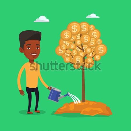 Férfi locsol pénzfa afrikai befektetés pénz Stock fotó © RAStudio
