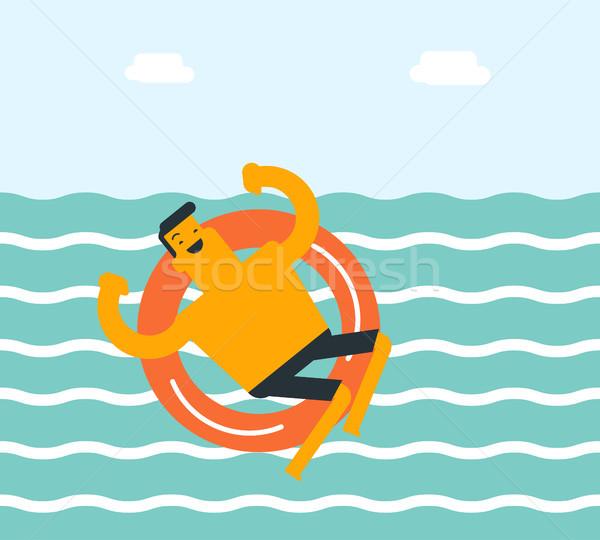 Young caucasian white man swimming with lifebuoy. Stock photo © RAStudio