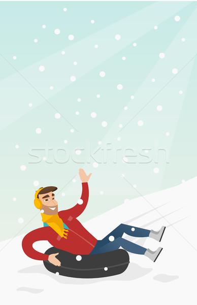 Férfi hó gumi cső hegyek fiatal Stock fotó © RAStudio