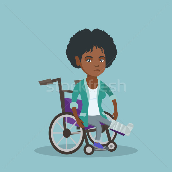 Stock photo: Woman with broken leg sitting in a wheelchair.