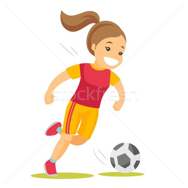 Caucasian white soccer player kicking the ball. Stock photo © RAStudio