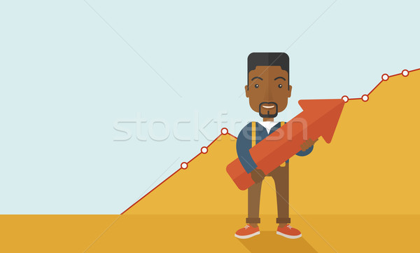 Happy black guy holding arrow up sign. Stock photo © RAStudio