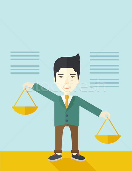 Japanese man holding a weighing scale. Stock photo © RAStudio
