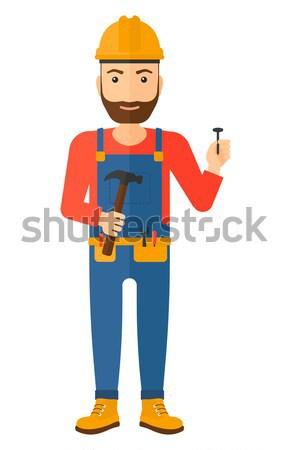 Friendly builder with arms crossed. Stock photo © RAStudio