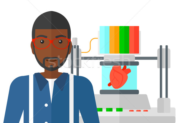 Stock photo: Man with three D printer.