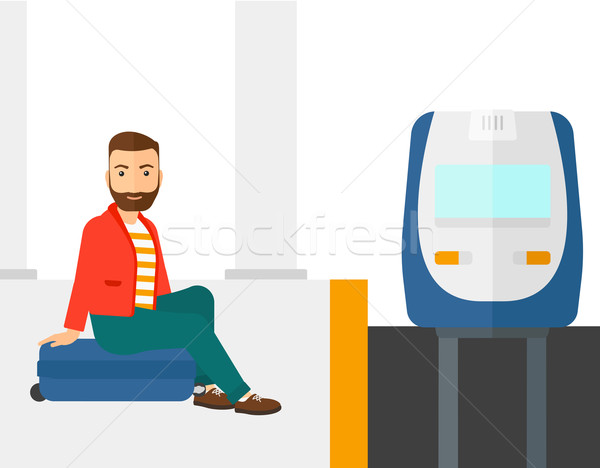 Man sitting on railway platform. Stock photo © RAStudio