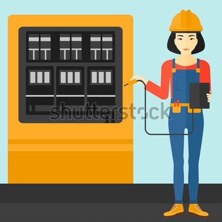 Electrician with electrical equipment. Stock photo © RAStudio