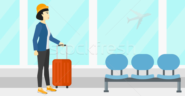 Woman at airport with suitcase. Stock photo © RAStudio