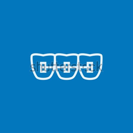 Orthodontic braces line icon. Stock photo © RAStudio