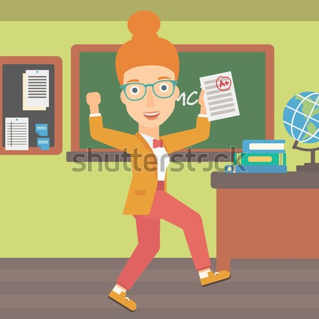 Student holding test paper with best result. Stock photo © RAStudio