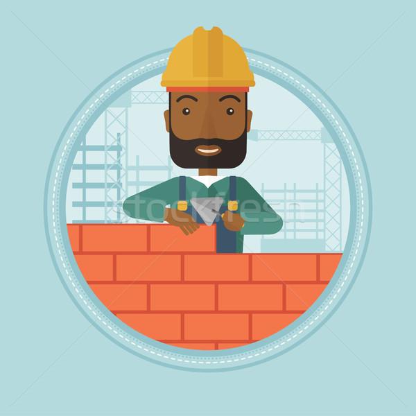 Bricklayer building brick wall vector illustration Stock photo © RAStudio