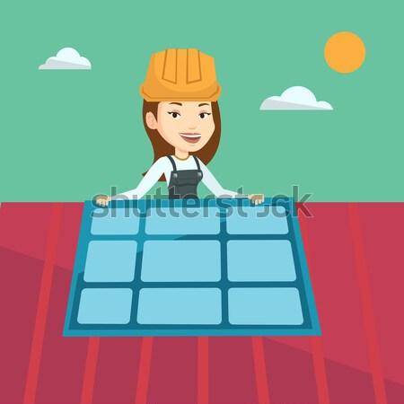 Constructor installing solar panel. Stock photo © RAStudio