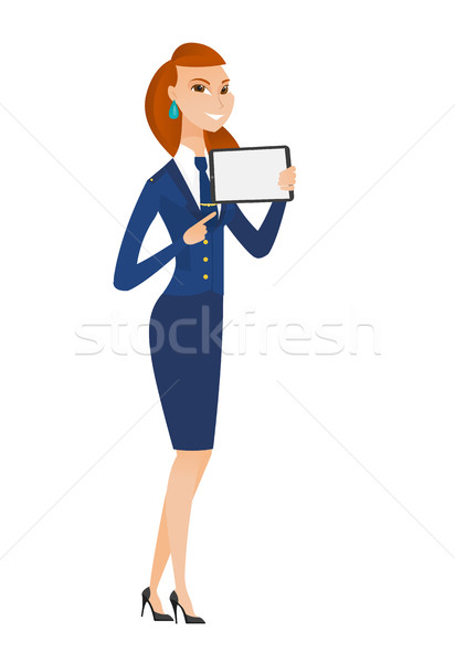 Smiling stewardess holding tablet computer. Stock photo © RAStudio