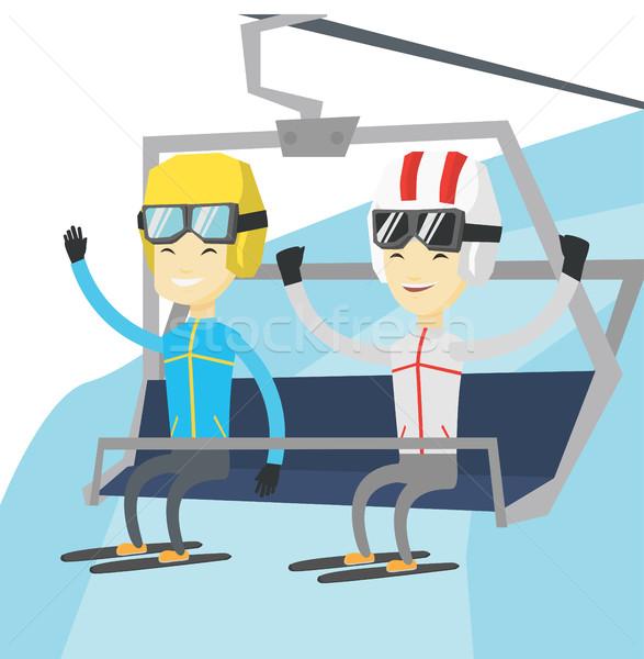 Two happy skiers using cableway at ski resort. Stock photo © RAStudio