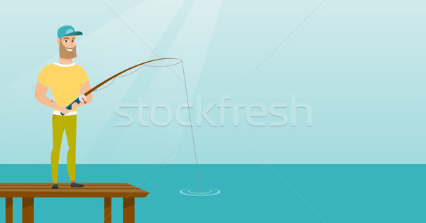 Young caucasian man fishing on jetty. Stock photo © RAStudio