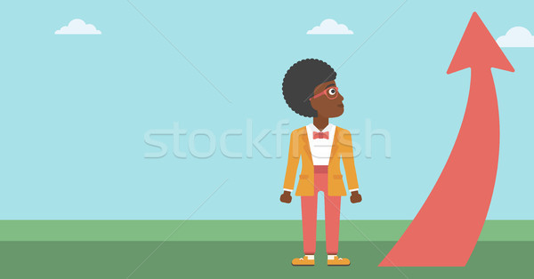 Stock photo: Business woman looking at arrow going up.