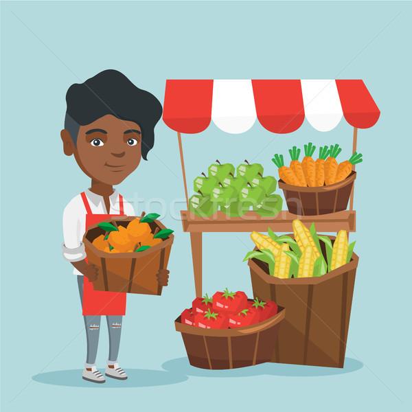 африканских улице продавец плодов овощей молодые Сток-фото © RAStudio