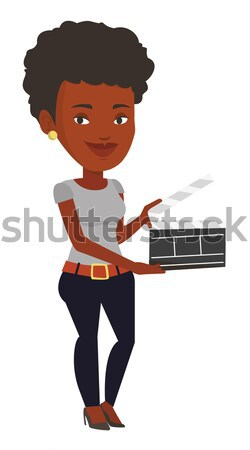 African-american woman holding open clapperboard. Stock photo © RAStudio