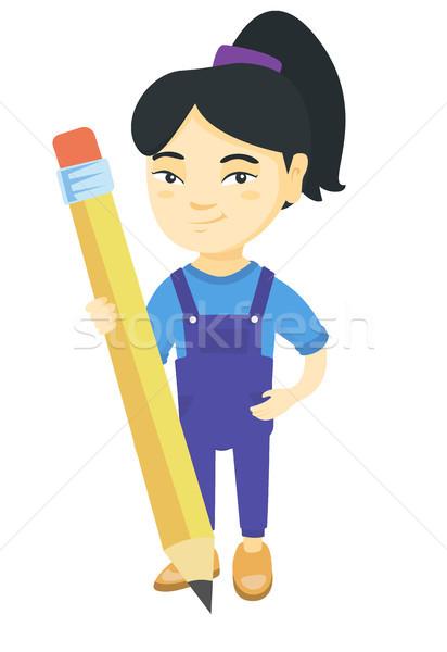 Asian kid ragazza piedi enorme matita Foto d'archivio © RAStudio