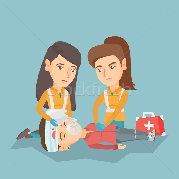 Emergency doing cardiopulmonary resuscitation. Stock photo © RAStudio