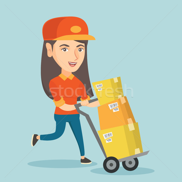 Woman-postman pushing the trolley with parcels. Stock photo © RAStudio